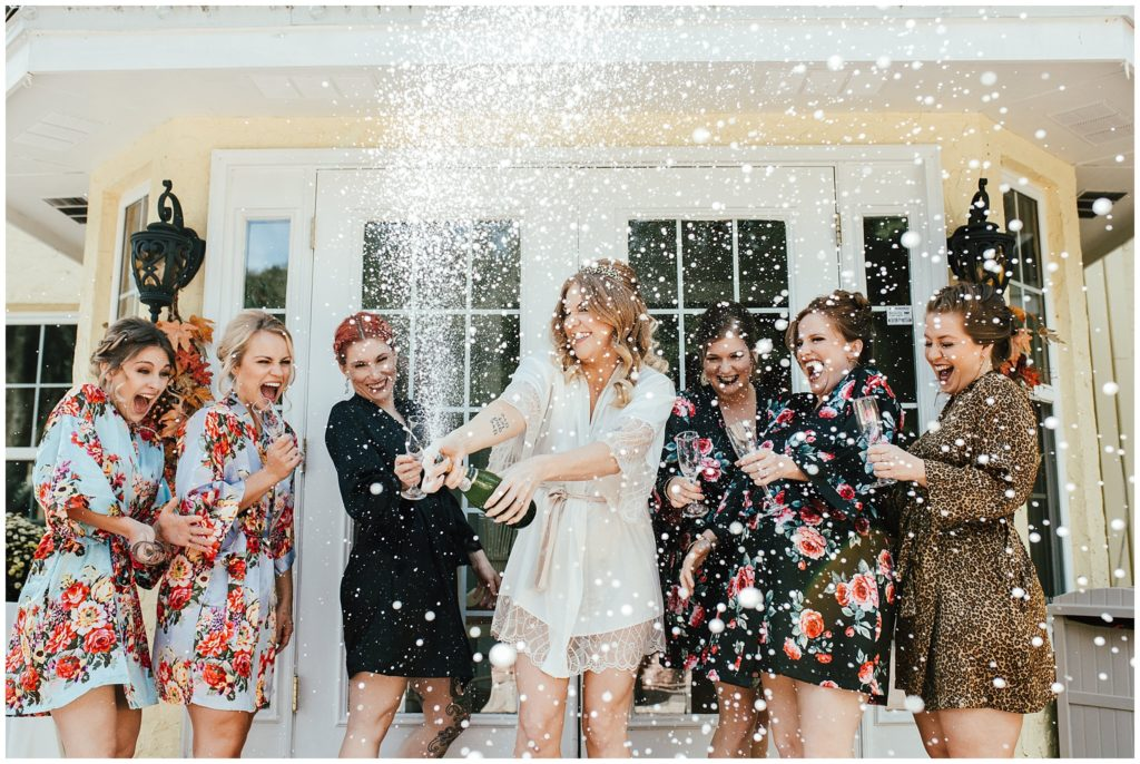 Casa Lantana, Casa Lantana wedding, Casa Lantana wedding photos, Casa Lantana wedding photographer, bride and bridesmaids spray champagne,